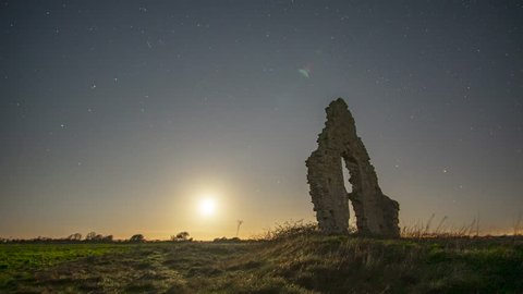 Moonset going to yellow at Midley Church ruin in Old Romney, Kent. Stars moving in background