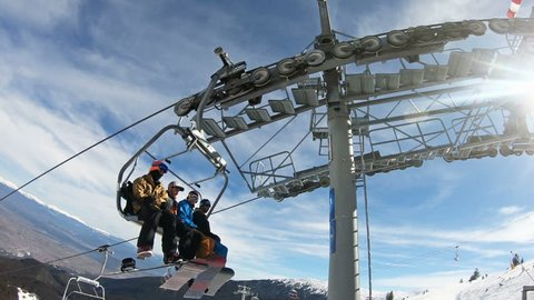 Bansko, Bulgaria - circa Feb, 2018: People at chairlift elevation on the top of the mountain peak Todorka in Bansko, Bulgaria. Bansko is the most popular ski resort in South-east europe where the worl