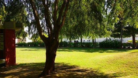 Ahmedabad, Gujarat, India - Circa 2018: Panning shot of courtyard garden of sabarmati ashram ahmedabad gujarat with statue of mahatma gandhi. This memorial of Mahatma and Kasturba gandhi housed their