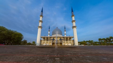 Low Angle Dramatic Sunrise Time Lapse with moonset at a mosque. Shah Alam, Malaysia. Slide down motion timelapse.