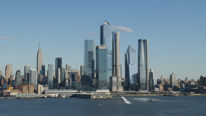 The mixed-use Hudson Yards real estate development and other buildings on the West Side of Manhattan in New York City. | Shutterstock HD Video #1025889518