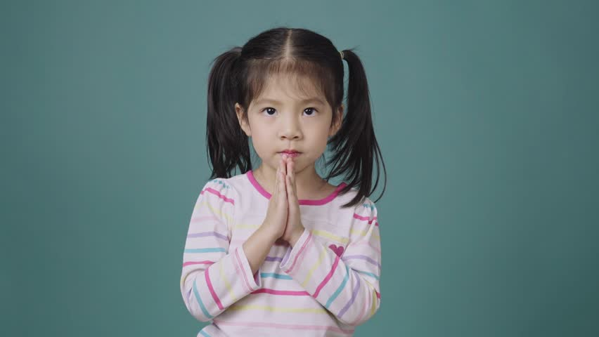 Portrait of little asian girl sing a song and clapping her hand over the blue background, Music concept for school kids | Shutterstock HD Video #1025893148