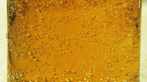 foam beer in a glass goblet close up