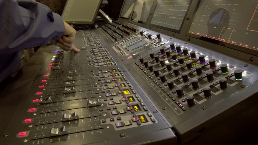 Handheld Shot of Sound Engineer Teaching Digital Audio Mixing Equipment 01.MOV | Shutterstock HD Video #1025958158