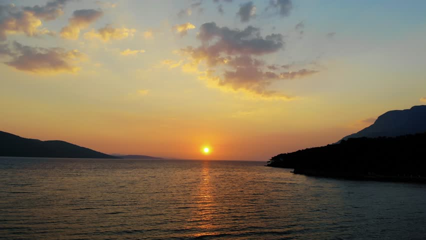 A late autumn sunset video from Akyaka coastline (Gulf of Gokova, the Aegean Sea) shot with a drone flying over the sea.  | Shutterstock HD Video #1025973278