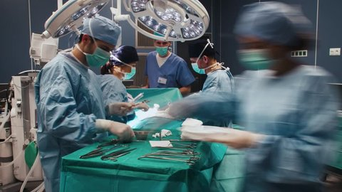Time lapse view of difficult operation of busy surgeons
