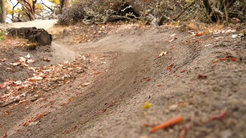 Slow motion close up of mountain bike tire sliding down a turn