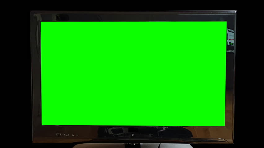 Modern flat Tv Green Screen on black Background Zooming out Slowly. Replace green screen with your own text or footage. | Shutterstock HD Video #1026014648