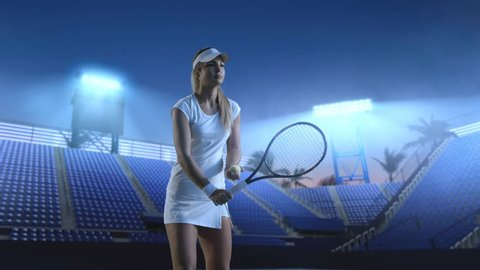 Tennis girl on a professional tennis court in evening.