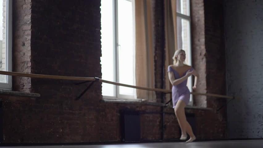 Defocusing jump of the ballerine in slow motion.   Shutterstock HD Video #1026038648