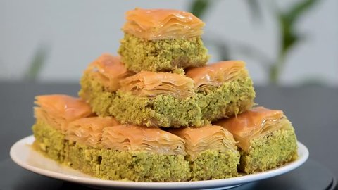 Serving Baklava or as it might be written as Baklawa, on rotating plate, a lot of pistachio