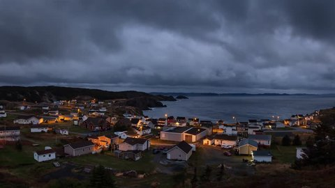 Panoramic view of a small town on the Atlantic Ocean Coast during a dark cloudy sunset. Taken in Crow Head, North Twillingate Island, Newfoundland and Labrador, Canada. Still Image Animation