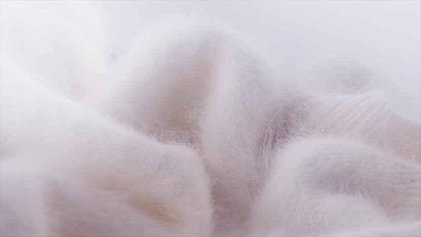 Soft Mohair Wool background. Alpaca wool mohair clothes texture closeup. Natural Cashmere Soft and fluffy merino wool macro shot. Woolen fabric. Knitted hairy detail texture Rotated. 4K UHD slowmo | Shutterstock HD Video #1026179168