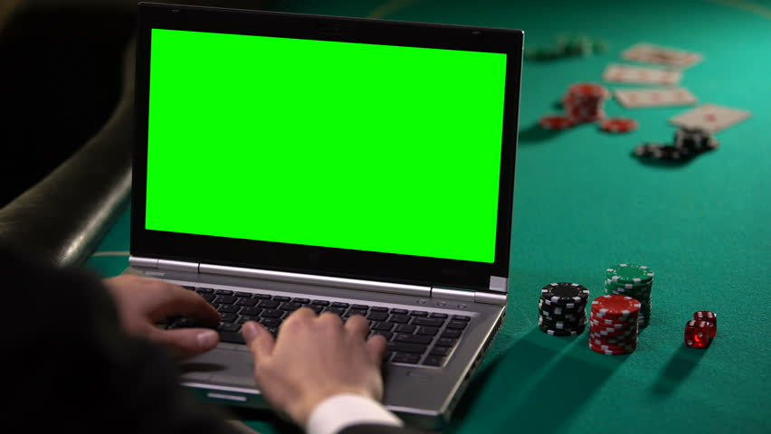 Male gambler betting poker online on laptop, holding lucky dice, green screen | Shutterstock HD Video #1026198308