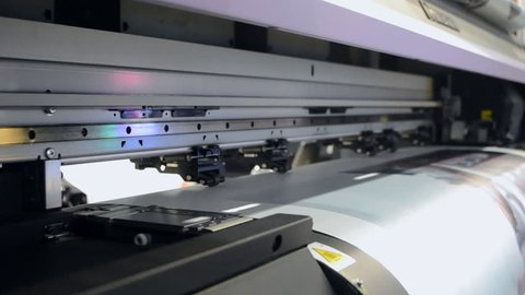 Large format printer works close-up  large format printing press printing  on paper  printhead close up