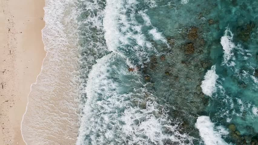 Drone footage of crystal clear blue water and waves on the shore of beach in Cebu Philippines | Shutterstock HD Video #1026302948