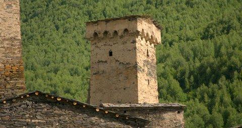 Zoom out from close up of of the stone medieval fortified Svaneti tower houses of  Ushguli, Upper Svaneti, Samegrelo-Zemo Svaneti, Mestia, Georgia.