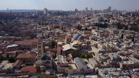 Aerial of Old City Jerusalem and the domes and courtyard of Church of the Holy Sepulchre.
