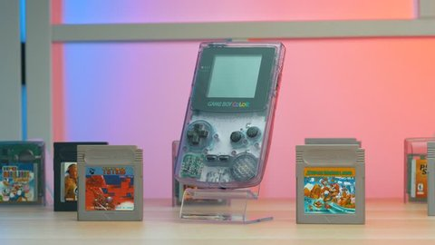 MONTREAL, CANADA - March 2019 : Gaming system from the 90s from Nintendo: Gameboy Color and many cassettes games.