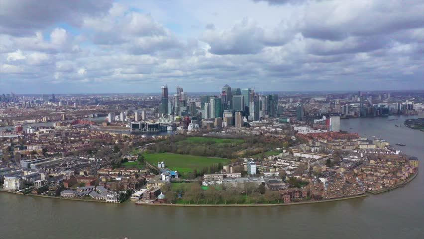 Aerial bird's eye view panoramic drone video of Greenwich park with views to Canary Wharf and University of Greenwich with beautiful cloudy sky, Isle of Dogs, London, United Kingdom #1026441728