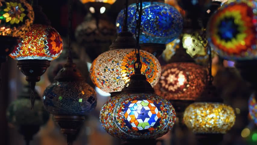 Camera moving from left to right throught traditional turkish lamps at night time   Shutterstock HD Video #1026446588