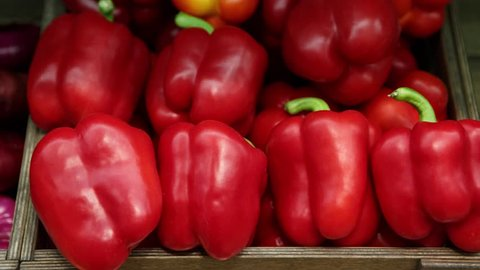 Footage of fresh ripe red sweet bell pepper in box on sale at grocery food store.Rich vitamine ingredients for salad healthy eating,diet and good taste