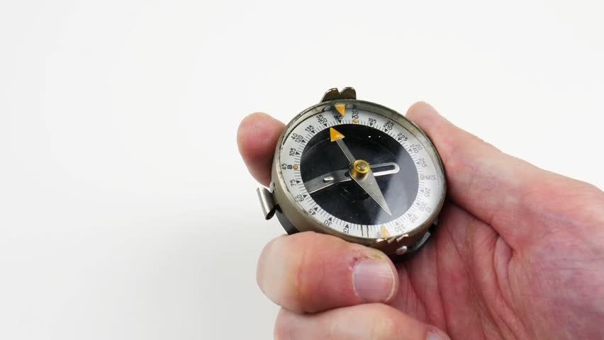 Compass in man's hand. Close up | Shutterstock HD Video #1026490388