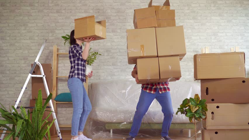 Fale man falls with boxes, problems when moving to a new apartment | Shutterstock HD Video #1026519848