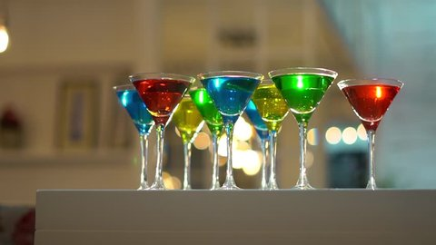 Christmas or New Year Drinks for Gala Dinner or Cocktail Party Event. Colored cocktails on the bar.