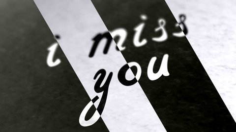 """i miss you"" in the page. Negative image. Looping footage has 4K resolution. Illustration."