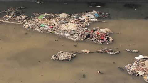 Dirty river in Dharavi slums. Gas formation from the dirty river. Mumbai. India.