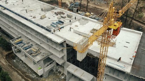 Aerial view big construction crane, close up. Construction crane on a building background, close up.