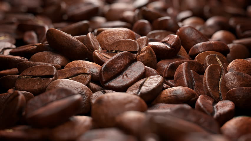 Wonderful close-up of coffee beans on a white background. Camera move along the coffee beans (4K,ultra high definition 2160p, seamless loop) | Shutterstock HD Video #1026702218