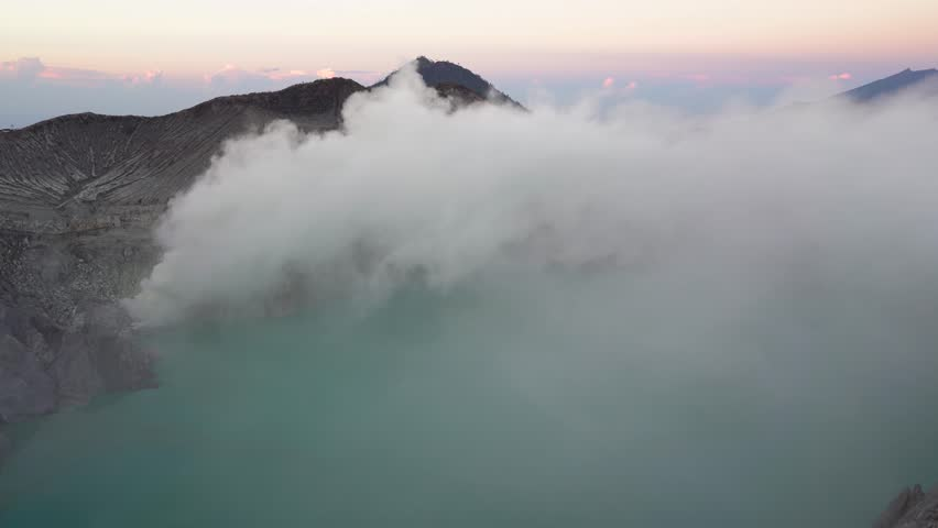 Panorama natural landscape of volcano crater at sunrise scene. The sulfuric lake of Kawah Ijen vulcano  | Shutterstock HD Video #1026703838