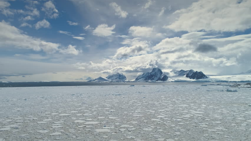Antarctica Timelapse. Snow Iceberg Drift Wild Nature Aerial View. Epic Glacier Surface Landscape. Frozen Antarctic Climate Change Pole Continent Scenery Drone Hyperlapse Overview Shot Footage 4K (UHD) | Shutterstock HD Video #1026731408