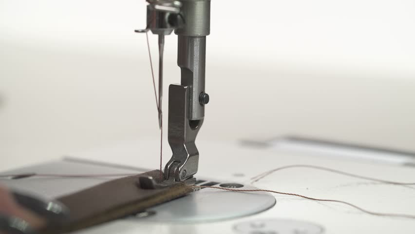 Leatherworker finishes sewing leather parts. Leather cloth stitching on sewing machine in action | Shutterstock HD Video #1026792908