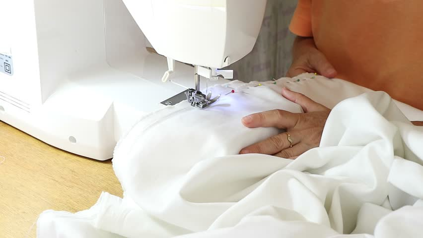 Hoby of homemade sewing making a white sweater using the sewing machine | Shutterstock HD Video #1026807548