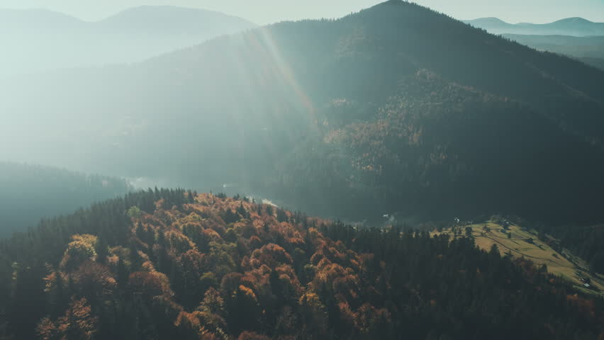 Highland Ravine Rural Village Sun Beam Aerial View. Scenic Foggy Hill Attraction Soft Sunrise Light Wild Nature Forest Clean Natural Ecology Countryside Tourism Concept Drone Flight Footage 4K (UHD)