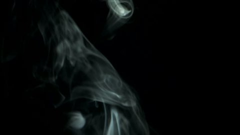 Thin trickle smoke rising graceful twists upward. Cigar smoke blowing from bottom to top. Natural color tobacco smoke. Great for editing, video without color correction and grading, 4K - 60fps