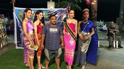 A group of gorgeous ladyboy is photographed with tourists on the embankment of Pattaya, Suanthai. Pattaya, Thailand, 03.04.2019