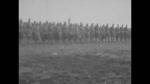 Circa 1918 - troops of the 79th division march for review before generals  pershing, kuhn, and other officers