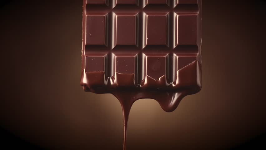 Chocolate bar with melted dark chocolate dripping over dark brown background. Confectionery concept backdrop. Melted premium chocolate flowing. Sweet dessert. 4K UHD video, slow motion | Shutterstock HD Video #1026936338