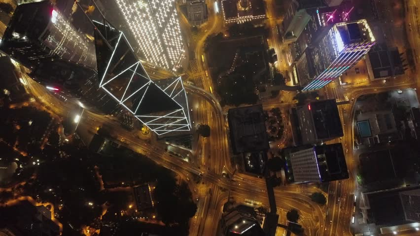Aerial view of the city at night with modern buildings, highway intersection and moving cars. Big city nightlife. | Shutterstock HD Video #1026979508