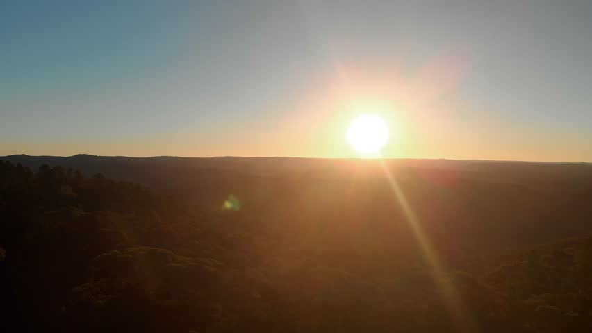 Aerial panoramic view of Blue Mountains (Sydney, Australia) at Sunset followed by the drone setting down behind eucalyptus trees on a hill   Shutterstock HD Video #1027034078