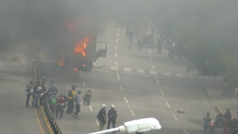 Protest for freedom in Venezuela. Protestants burn a truck during the riots against the communist government of Venezuela in the city of Caracas in Circa april year 2017