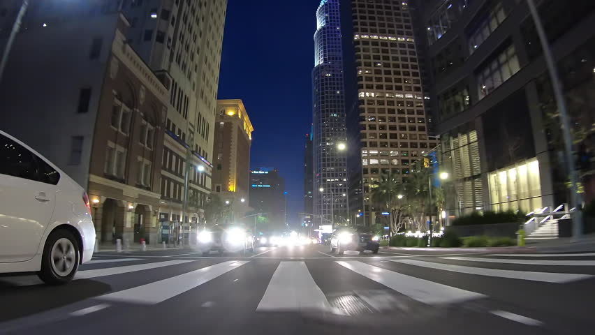 Los Angeles California USA - March 31, 2019:  Rear view night driving view of buildings on Figueroa Street in urban downtown L.A. | Shutterstock HD Video #1027090328