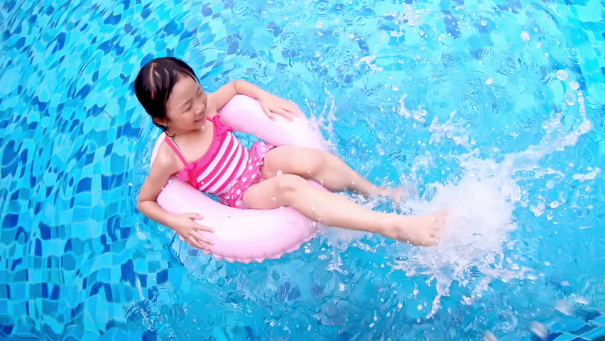 Cute girl play with floating ring in the swimming pool | Shutterstock HD Video #1027106618