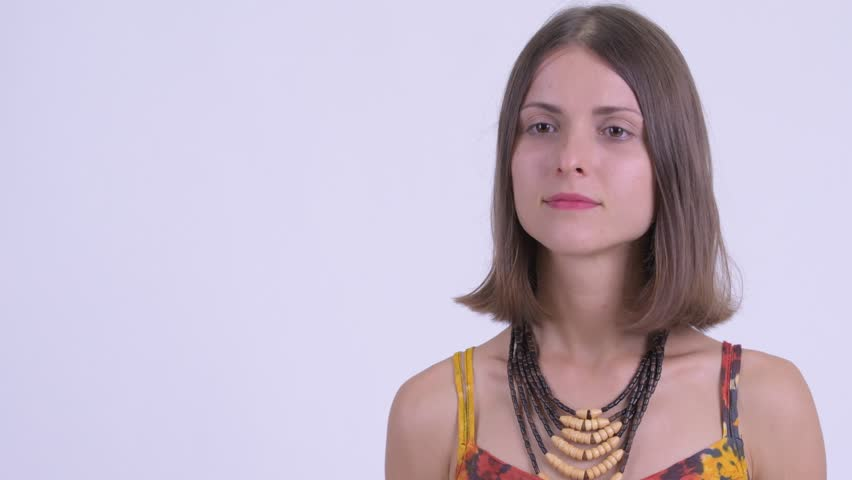 Face of happy young beautiful hipster woman talking | Shutterstock HD Video #1027111988