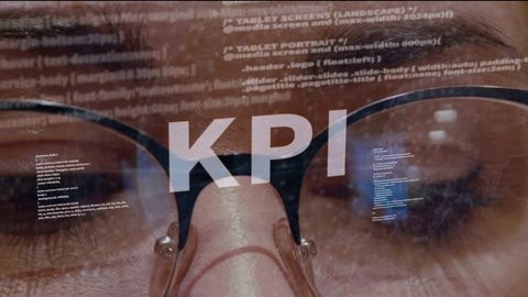 KPI text on the background of female software developer. Eyes of woman with glasses are looking at programming network code space abstract technologies connecting global data network