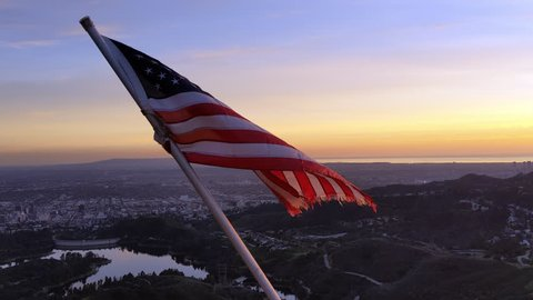 American Flag (USA) Flying In The Wind over the Hollywood Hills At Sunset